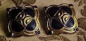 Vintage Trifari gold and black enamel clip earrings