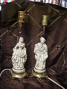 French Colonial white and gold man and woman matching table lamps 40's