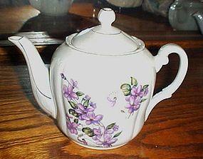 Lovely vintage porcelain teapot with violets
