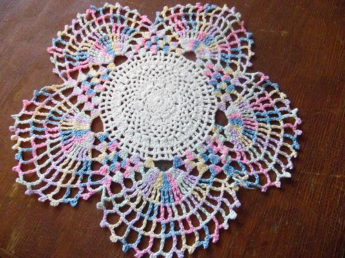 Vintage hand crochet varegated pastel round doily