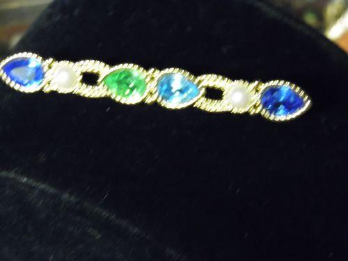 Beautiful Monet gold tone rhinestone bar pin