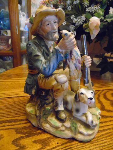 Large vintage Norleans hunter and his dog figurine