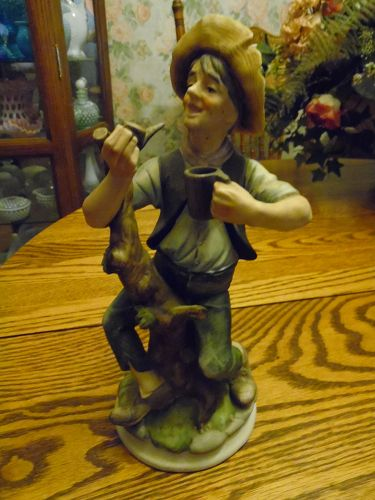 Homco style bisque figurine of man and a tree stump smoking pipe