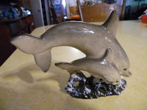 Ceramic dolphin and baby jumping ocean waves figurine