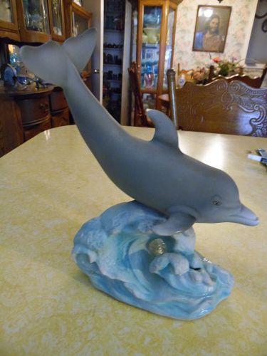 Large bisque porcelain dolphin figurine