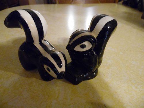 Vintage California pottery skunk figurines