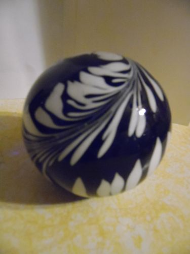 Black and white feather plume glass paperweight