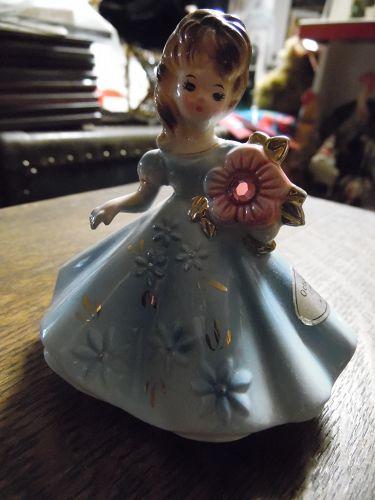 Josef Originals October birthstone girl with opal flower
