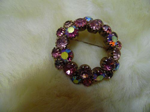 Lovely pink aurora rhinestone circle brooch 1.75 inch
