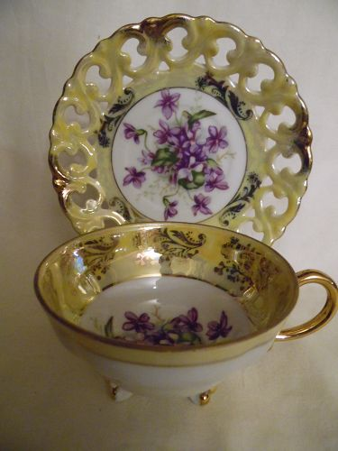 Vintage Royal Sealy Japan Fancy yellow with violets teacup and saucer