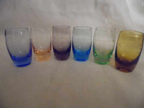 vintage set of colored shot glasses with cut design