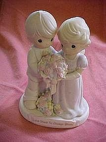 """""""Love vows to always bloom"""" Precious moments figurine cake topper"""