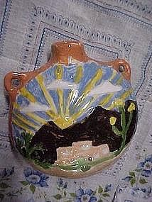 Small red clay vase with old pueblo scene