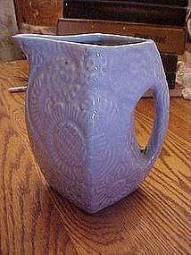 Old Niloak  pitcher , embossed floral, blue glaze