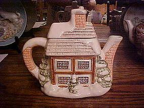 Snow covered house,  ceramic tea pot