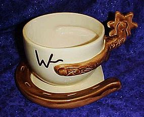 Oversized Western cup and saucer, horseshoe and spur