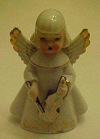 vintage angel figurine playing violin