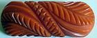 Bakelite  heavily carved orange leaf bar pin (Vintage)