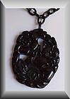 Bakelite carved floral pendant & chain - Vintage