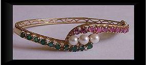 14K hinged bangle bracelet, emeralds, rubies, pearls
