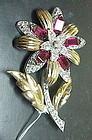 Reja gold tone rhinestone floral brooch