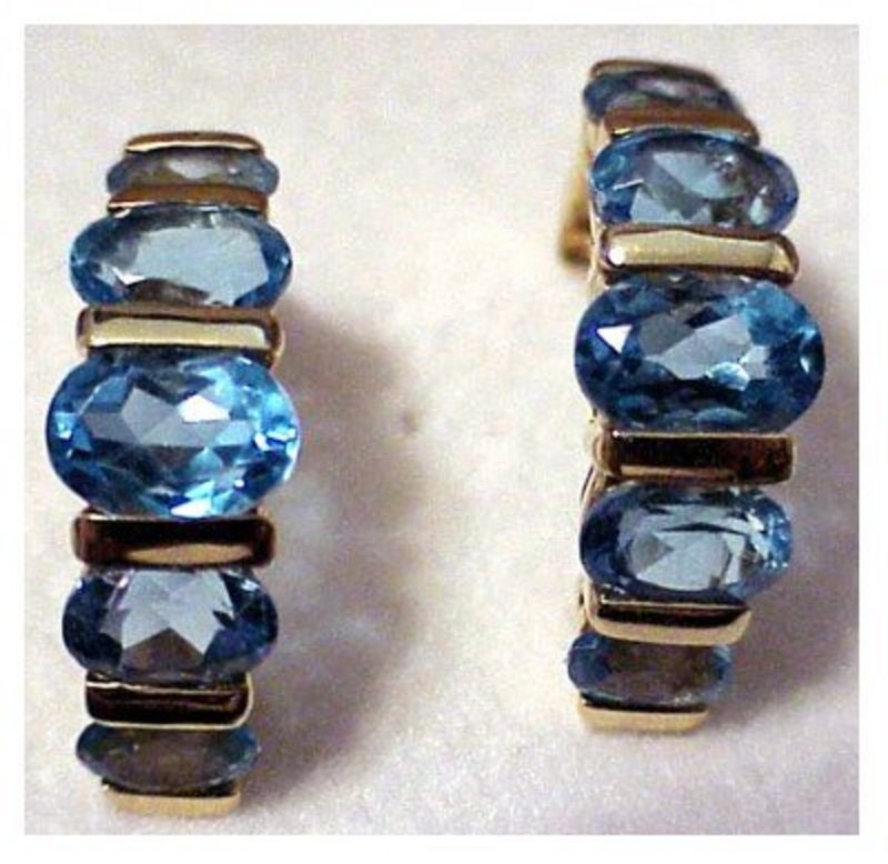 14K yellow gold 5 Stone 5 cts. oval topaz earrings