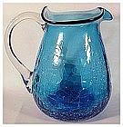 "Crackle glass 5 1/4"" blue pitcher (Pilgrim)"