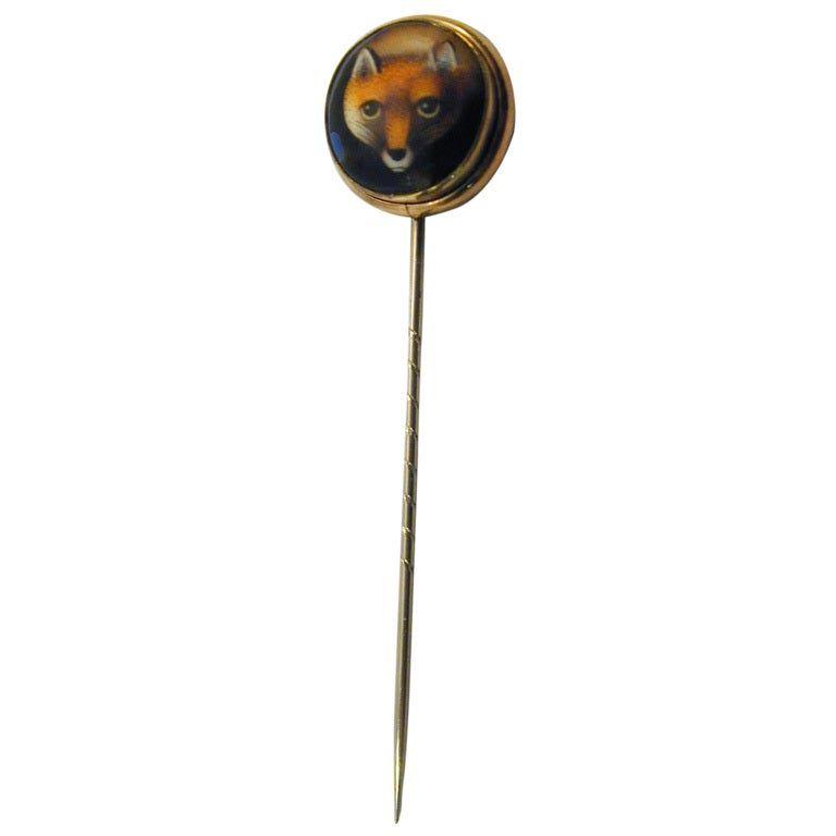 Stickpin of an enameled foxhead set in 15K gold