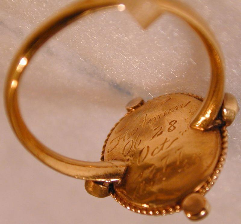 "Ring, Memorial for ""John Hulman"" set with a hair curl"