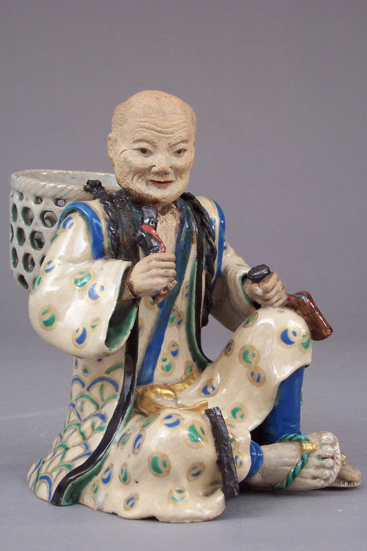Japanese Kyo-Satsuma enamel decorated stoneware figure