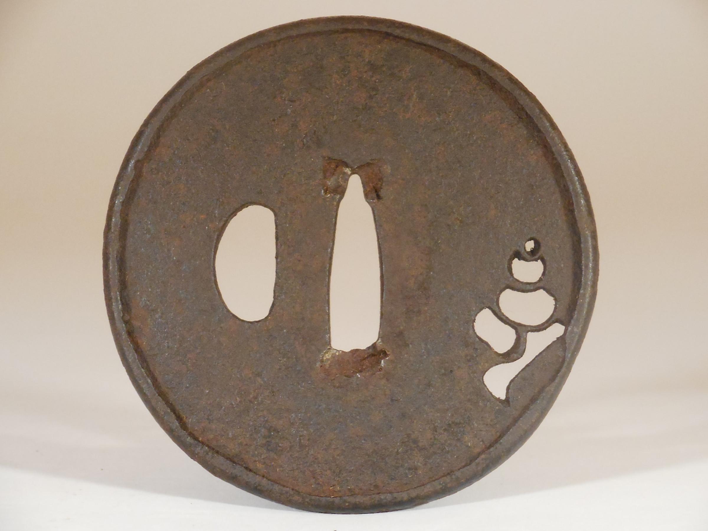 Small Ko-katchushi Iron Tsuba with Sukashi Decoration of a Conch Shell