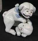 Japanese porcelain two puppies sculpture