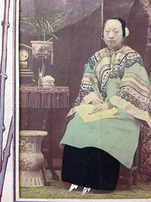 Old Chinese photo of a lady with lily lotus shoes