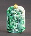 Jadeite dragon pendant with gold loop