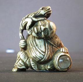 Antique stag antler nestsuke man with toad