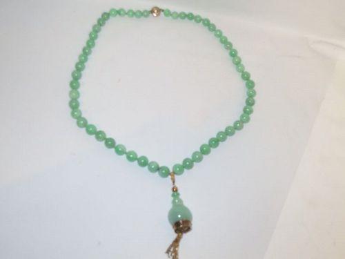 Jadeite necklace 14k gold and diamond