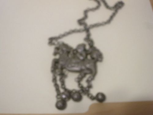 silver color necklace of the Qiling and rider