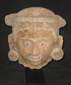 A VISUALLY STRIKING MASSIVE HEAD OF A MAYA DIGNITARY