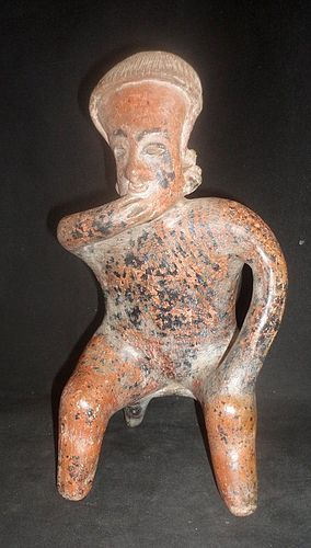 A LARGE NAYARIT SEATED BENCH FIGUERE FROM WEST MEXICO