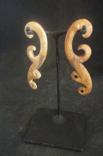 AN ELEGANT PAIR OF PACIFIC ISLAND ANTIQUE EAR DECORATIONS