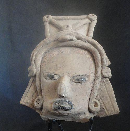 A LARGE SKILLFULLY MOLDED VERACRUZ HEAD FRAGMENT