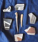 AN OUTSTANDING GROUP OF 6 MIMBRES POTTERY SHERDS  WITH TWO BONE A