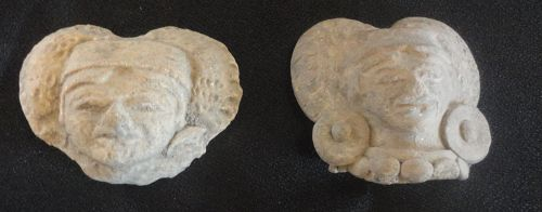 A PAIR OF MOLDED HEADS OF MAYA NOBLES