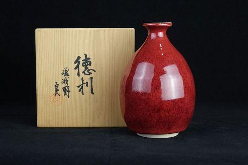 Yoshinori Izumi (b. 1947) Kyo ware Red Glaze Tokkuri (Sake Bottle)