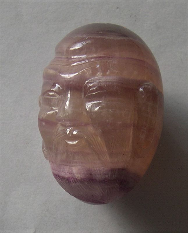 Chinese banded amethyst carved with head of an immortal