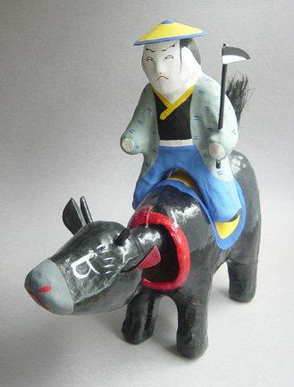 Miharu Hariko Papier-mache Doll, Farmer Riding Cow