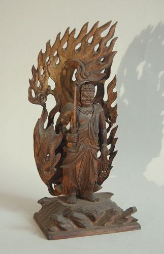 Wooden sculpture of Fudo Myoo surrounded by flames, Japan