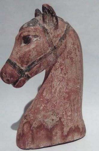 An Egyptian Gesso and wood Painted Horse Head
