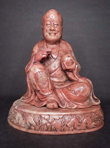 Antique steatite figure of a seated Lohan or Buddha