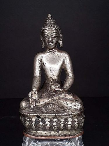 Tibet antique cast silver Medicine Buddha with sealed copper base